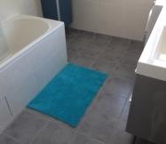 petit rappel de la couleur du meuble grâce à ce tapis