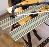Le découpage des rails s'est fait avec une scie à métaux.