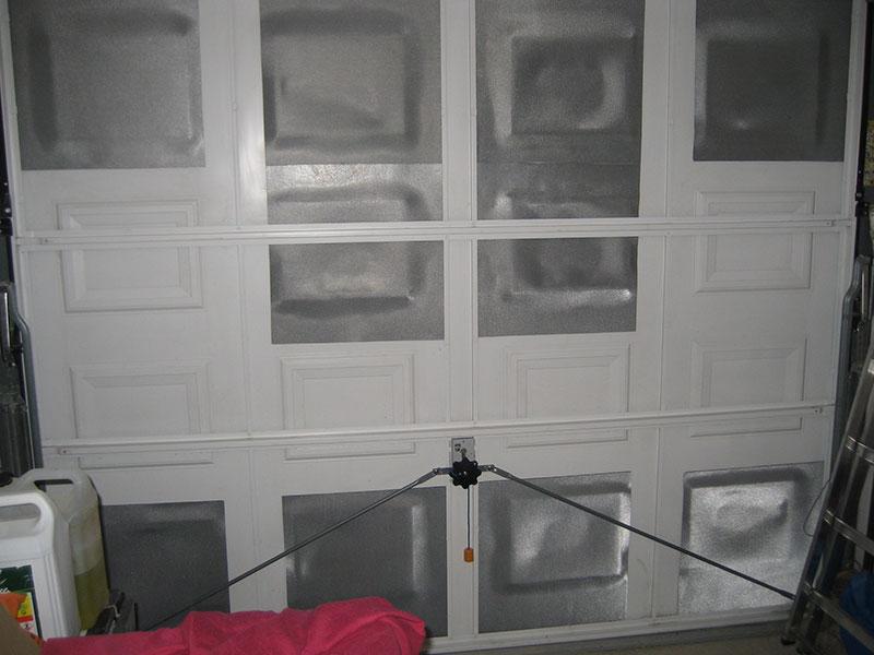 début des travaux d'isolation de notre porte de garage