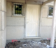 Porte de notre Maison Phénix